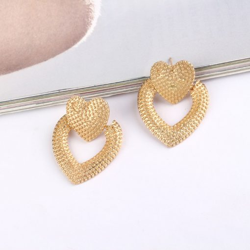 Europe and America heart-shaped  earrings Personality alloy retro wind hollow earrings female ylx-071
