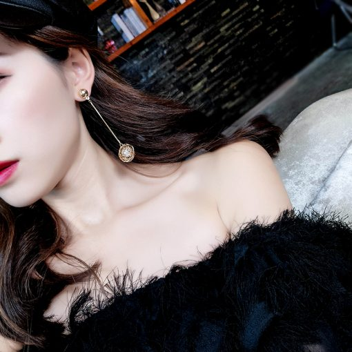 Korean version of the hollow gold silk ball pearl earrings female  temperament long pendant personality exaggerated earrings YLX-123